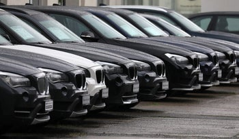 Used BMW luxury automobiles stand outside a Bayerische Motoren Werke AG showroom in Berlin, Germany, on Wednesday, July 26, 2017. Carmakers' shares have dropped since Spiegel magazine reported Friday that Daimler and Volkswagen informed authorities last year of discussions they'd had since the 1990s that also included BMW AG. Photographer: Krisztian Bocsi/Bloomberg