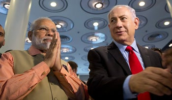 Indian Prime Minister Narendra Modi, left, and Israeli Prime Minister Benjamin Netanyahu attend an Innovation conference with Israeli and Indian CEOs in Tel Aviv, Israel, Thursday, July 6, 2017. (AP Photo/Oded Balilty, Pool)
