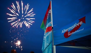 Germany's far-right Alternative for Germany (AfD) party burns private fireworks during an election campaign tour by ship on the river Rhine near Krefeld, Germany, September 4, 2017.