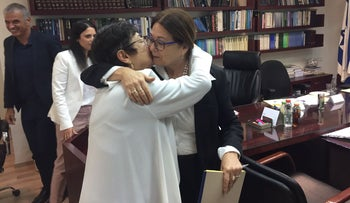 Outgoing Supreme Court President Miriam Naor embraces her successor, Esther Hayut (right), following her selection, while ministers Ayelet Shaked and Moshe Kahlon look on, September 5, 2017.
