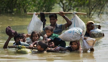 A Rohingya family reaches Bangladesh after crossing a creek on the border with Myanmmar, September 4, 2017.