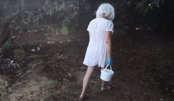 A still from Sharon Fidel's video about burying her old heart.