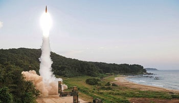FILE, In this Monday, Sept. 4, 2017 file photo provided by South Korea Defense Ministry, South Korea's Hyunmoo II ballistic missile is fired during an exercise at an undisclosed location in South Korea