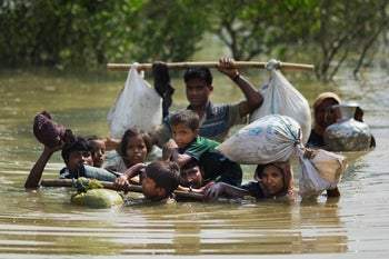 A Rohingya family reaches the Bangladesh border after crossing a creek of the Naf river on the border with Myanmmar, in Cox's Bazar's Teknaf area, Tuesday, Sept. 5, 2017. (