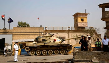 Egyptian security forces stand guard outside one of the entrances of Tora prison, in Cairo, Egypt, in this Aug. 2, 2015 file photo.