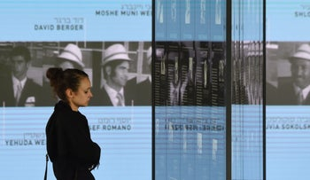 """A visitor looks at the portraits of the Israeli athletes murdered inside """"The Munich 1972 Massacre Memorial"""" dedicated to the 1972 Olympic attack in Munich, Germany, September 6, 2017."""