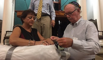 Congregants at Charleston's Kahal Kadosh Beth Elohim wrap their Torah scrolls in protective plastic ahead of Hurricane Irma.