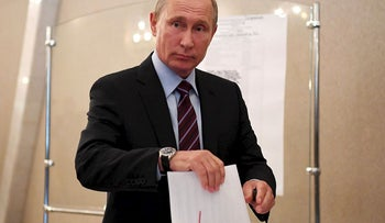 Russian President Vladimir Putin casts his ballot at a polling station during the municipal elections in Moscow, Russia, September 10, 2017