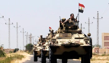 Soldiers in military vehicles northeast of Cairo, Egypt May 21, 2013.
