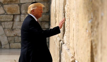 U.S. President Donald Trump leaves a note at the Western Wall in Jerusalem May 22,