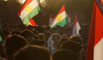 Iraqi Kurds flying Kurdish flags, urging people to vote in the upcoming independence referendum in Arbil, the capital of the autonomous Kurdish region of northern Iraq, on September 13, 2017