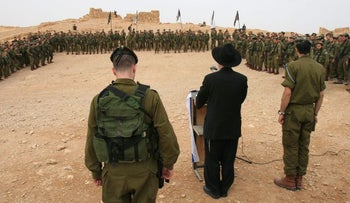 A basic training graduation ceremony held for troops from the Haredi Nahal battalion at Masada in 2012.