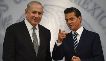 Israel's Prime Minister Benjamin Netanyahu speaks speaks with Mexican President Enrique Pena Nieto at the Los Pinos Residence in Mexico City, on September 14, 2017.