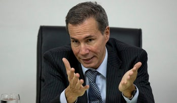 File photo: Alberto Nisman, the prosecutor investigating the 1994 bombing of the Argentine-Israeli Mutual Association community center, talks to journalists in Buenos Aires, Argentina, May 29, 2013.