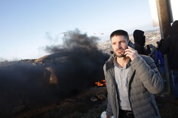 File photo: MK Bezalel Smotrich at the illegal Amona outpost in the West Bank, February 1, 2017.