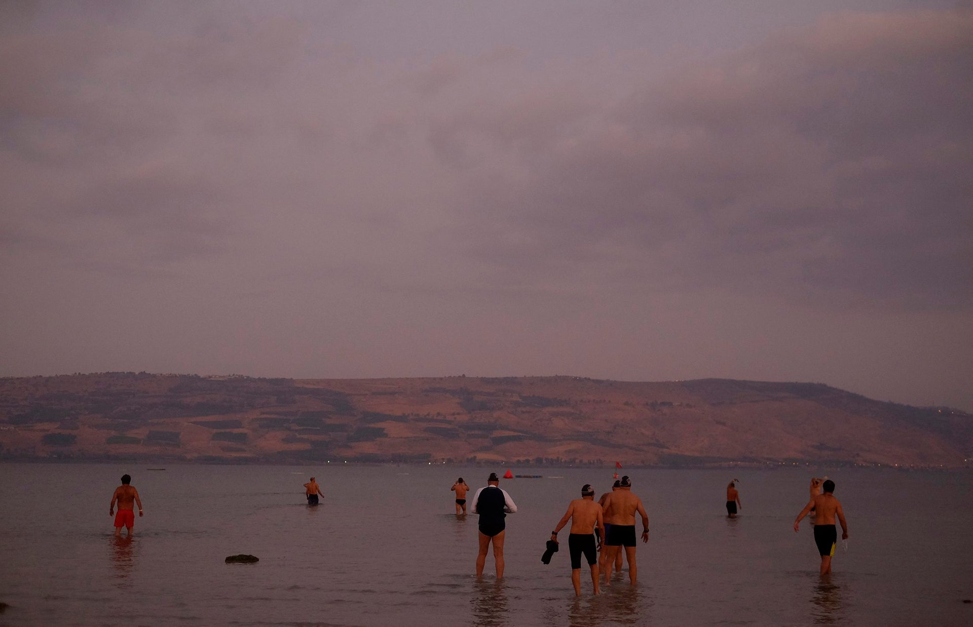 Swimmers participate in the annual Sea of Galilee swim, the oldest and largest popular swimming event, near Tiberias, northern Israel, Saturday, Sept. 16, 2017.