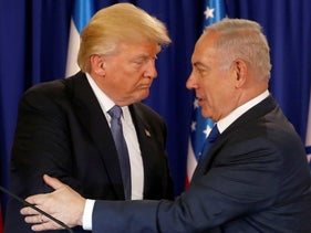 U.S. President Donald Trump and Israel's Prime Minister Benjamin Netanyahu embrace at Netanyahu's residence in Jerusalem. May 22, 2017