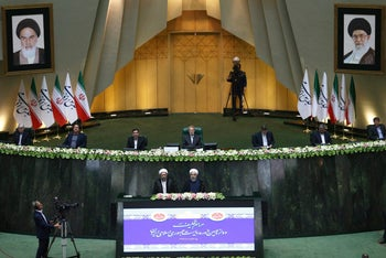 Iran's President Hasan Rouhani, bottom right, is sworn in for the second term in office. Tehran, Iran, Aug. 5, 2017