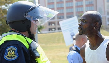 A protester and law enforcement officer are seen as protesters demonstrate following the acquittal of former St. Louis police officer Jason Stockley for the first-degree murder of black suspect Anthony Lamar Smith, September 15, 2017.