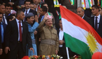 Iraqi Kurdish President Masoud Barzani salutes the crowd while attending a rally to show their support for the upcoming September 25th independence referendum in Duhuk, Iraq September 16, 2017.