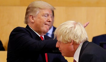 U.S. President Donald Trump pats British Foreign Secretary Boris Johnson on the back during a session on reforming the UN at its headquarters in New York, U.S., September 18, 2017.
