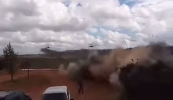 Moment of impact as Russian attack helicopters accidentally fire on bystanders