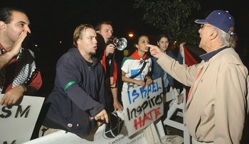 """In This file photo Arnold Citrin, right, of West Orange, N.J., a supporter of Israel, argues with pro-Palestinian demonstrators at an """"Israel Inspires"""" rally on the campus of Rutgers University in Piscataway, N.J."""