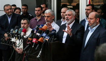 Hamas Chief Ismail Haniyeh speaks to the press upon his arrival to the Rafah border crossing in the southern Gaza Strip September 19, 2017.