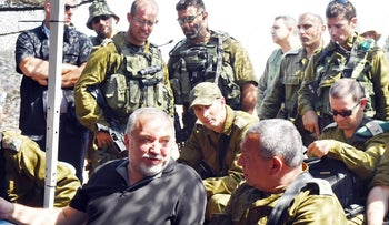 Defense Minister Avigdor Lieberman sits next to IDF Chief of Staff Gadi Eisenkot during a visit to a military exercise, September 12, 2017.