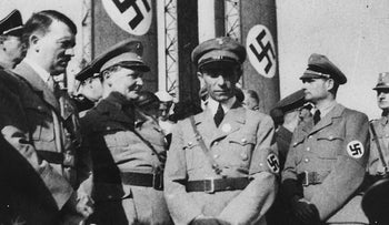 A 1933-34 photo of Adolf Hitler and other high ranking officials of the Nazi party, with Reich Minister of Propaganda Joseph Goebbels is pictured at center.