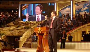 Joel Osteen preaching at Lakewood Church in Houston, Texas, where services are broadcast around the world.