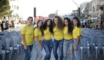 Young municipality volunteers pose while setting up for the evening Majdal Shams carnival following Id al-Adha, September 2017.