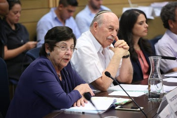 File photo: Supreme Court President Miriam Naor (L) attends a Knesset committee meeting flanked by Habayit Hayehudi MK Nissan Slomiansky and Justice Minister Ayelet Shaked, also of Habayit Hayehudi.