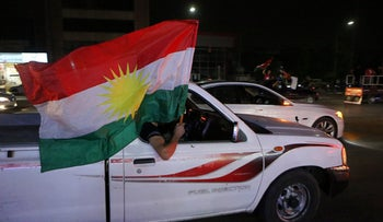 Iraqi Kurds celebrate in the streets after the polls closed in the controversial Kurdish referendum on independence from Iraq, in Erbil, Iraq, Sept. 25, 2017.