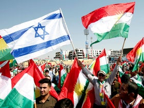 Kurds carry Israeli and Kurdish flags to show their support for the upcoming September 25th independence referendum in Erbil, Iraq September 22, 2017.