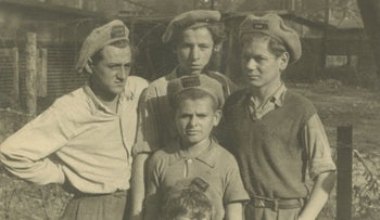 """Children posing for a photo in hats that read """"Exodus 1947"""" in a displaced persons camp in Germany, September 1947"""