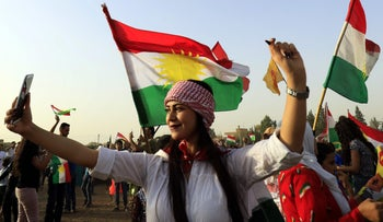 A Syrian Kurd takes a selfie during a gathering in support of the independence referendum in Iraq's KRG, Qamishli, Syria, September 26, 2017.