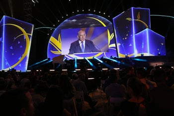 Prime Minister Benjamin Netanyahu's speech is broadcast on a large screen during the ceremony marking 50 years of settlement in the West Bank, September 29, 2017.