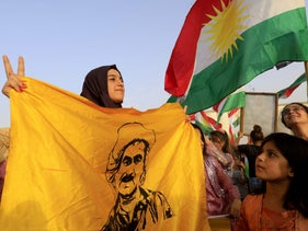 Syrian Kurds wave the Kurdish flag in support of the independence referendum. Northeastern Syrian city of Qamishli, September 26, 2017