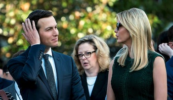 This file photo taken on September 11, 2017 shows White House Senior Advisor Jared Kushner (L) and wife Ivanka Trump on the South Lawn of the White House during a memorial service for the 9/11 terrorist attacks in Washington, DC
