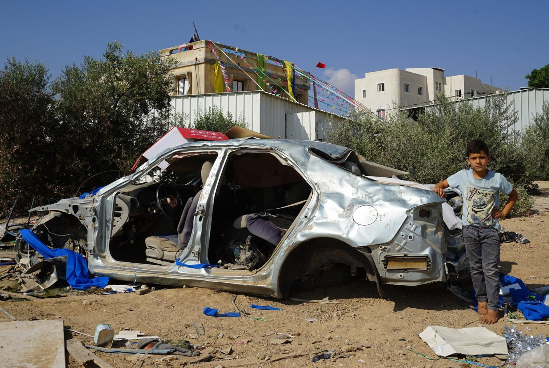 The Bedouin city of Rahat, a graveyard for rusting cars off Highway 40