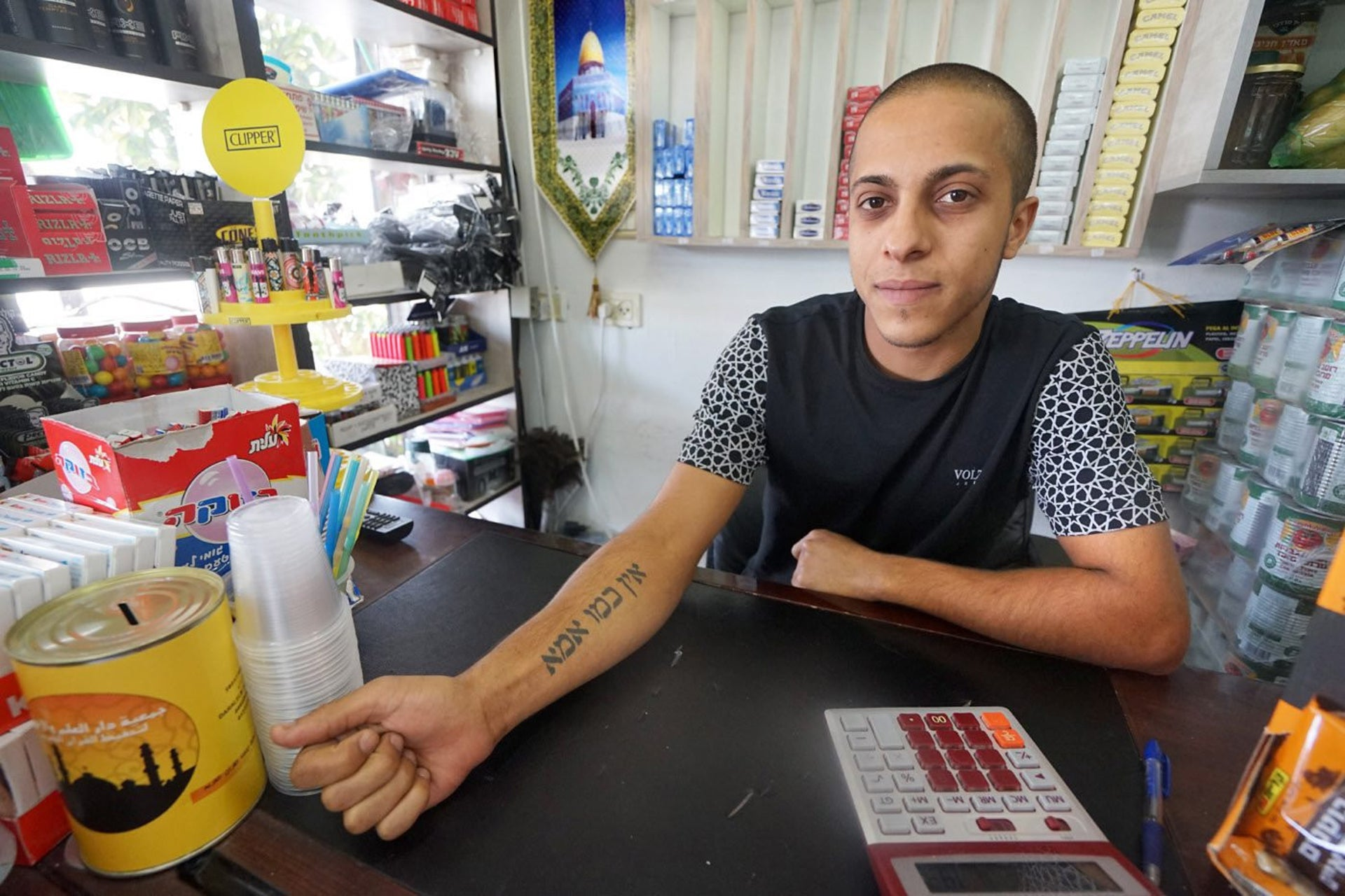 Salem Touri in the Brothers' Mini-Supermarket he opened five months ago in Rahat off Highway 40