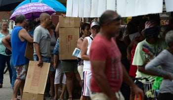 Residents from Juana Matos line up to buy supplies from a mini mart in Catano, Puerto Rico on Wednesday, September 27, 2017.