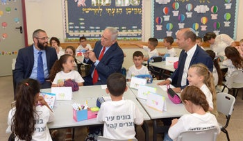 Education Minister Naftali Bennett and Prime Minister Benjamin Netanyahu visit a class of first graders to open the new school year, Harish, Israel, September 2, 2017.