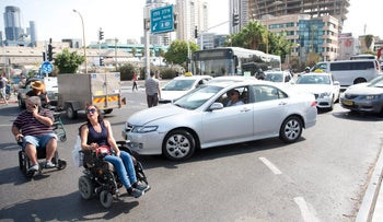 Disabled protesters block a Tel Aviv intersection, September 24, 2017.