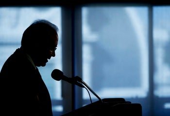 FILE - In this Sept. 28, 2017, file photo, Health and Human Services Secretary Tom Price is seen silhouetted as he speaks during a National Foundation for Infectious Diseases (NFID) news conference in Washington. Price announced Friday, Sept. 29, 2017, he is resigning amid criticism of his travel on private planes. (AP Photo/Pablo Martinez Monsivais, File)