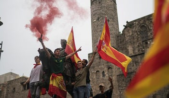 Protestores wave Spanish flags while demonstrating to defend the unity of Spain and against a disputed referendum on the region's independence that separatist politicians want to hold Sunday, in Barcelona Saturday, Sept. 30 2017. Catalonia's planned referendum on secession is due to be held Sunday by the pro-independence Catalan government but Spain's government calls the vote illegal, since it violates the constitution, and the country's Constitutional Court has ordered it suspended. (AP Photo/Felipe Dana)