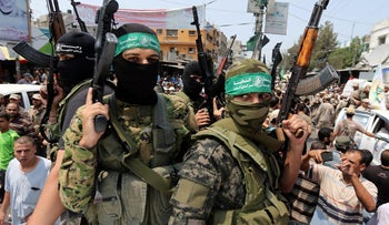 Palestinian Hamas militants attend the funeral of their comrade, in Rafah in the southern of Gaza Strip August 17, 2017.