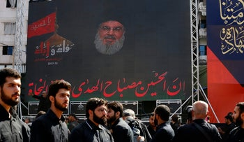 Hezbollah leader Sheik Hassan Nasrallah speaks via a video link during activities marking the holy day of Ashoura, in southern Beirut, Lebanon, Sunday, Oct. 1, 2017. Ashoura is the annual Shiite Muslim commemoration marking the death of Imam Hussein, the grandson of the Prophet Muhammad, at the Battle of Karbala in present-day Iraq in the 7th century