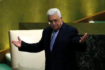 Palestinian President Mahmoud Abbas greets delegates after addressing the 72nd United Nations General Assembly at U.N. headquarters in New York. September 20, 2017